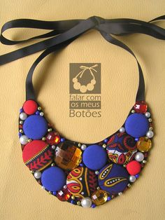 "necklace with african fabric covered buttons made by ""Falar com os meus botões"""
