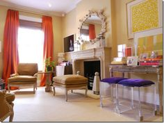 NY Living Room by Amanda Nisbet. Love the pop of purple in the lucite stools!