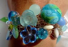 beach bracelet, wire crochet. I would love to do this with some found items scavenging the beaches of Hawaii.