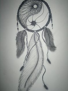 Make the middle feather smaller and put some beads between the feathers and the circle of the dreamcatcher