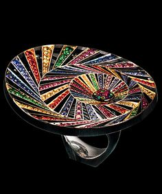 KALEIDOSCOPE RING 18K white gold 136 diamonds 0,90-0,95 ct 43 purple diamonds 0,50-0,60 ct 41 light sapphires 0,50-0,60 ct 55 orange sapphires 0,60-0,66 ct 62 yellow sapphires 0,60-0,66 ct 62 sapphires 0,81-0,85 ct 5 rubies 0,03-0,05 ct 44 tsavorites 0,52-0,57 ct 64 spinels 0,52-0,57 ct