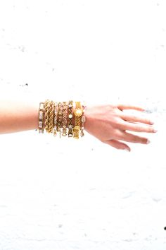 Dainty vintage bracelet stacking. Featuring gold, floral accents, and gemstones.