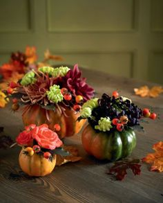 Autumnal artificial flowers housed in little pumpkins
