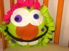"""Fleece monster pillow is absolute cute an silly addition to your child bedroom. Is perfect for both Boys and Girls 17"""" fleece tied pillow w/ felt facial features $25"""