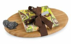 Mud Pie Turkey Bamboo Cutting Board Set by Mud Pie company. $14.98. 3 piece set. Oval bamboo cutting board set. Comes complete with 12 3-ply cocktail napkins, ceramic handle spreader and metal turkey icon. Finished with grosgrain ribbon.. Celebrate the bounty of the season. We've gathered together a collection of Thanksgiving classics that capture the spirit of the day.  From turkey-themed serving pieces to festive towels, there's something for every holiday feast!