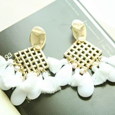 Gold detail White tassels and beading Large statement earrings