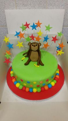 Bright colourful monkey cake with stars