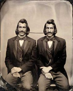 Conjoined twins share a hipster mustache.