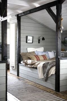 Such a cozy little space for a bed. I look beds in little nooks & crannies in houses. I would love to sleep here!