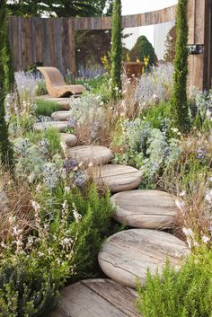 "Rounded natural wood ""stool seat"" pieces form this raised garden walkway. Rounded natural wood ""stool seat"" pieces form this raised garden walkway. Wood Walkway, Backyard Walkway, Backyard Landscaping, Walkway Ideas, Landscaping Ideas, Backyard Ideas, Garden Cottage, Diy Garden, Garden Paths"