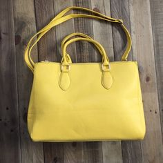 ✨Host Pick✨ NWOT yellow handbag New and never used bright yellow handbag. Also comes with little pouch that's perfect for makeup or travel. No PP or trades. Will consider offers. Street Level Bags