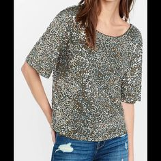 All Over Sequin Relaxed Tee New W/O tags, was going to wear for NYE, but it was too big for me. A relaxed tee you can call on when you really need to sparkle. Silver, gold and copper sequins cover the front and back of this V-back tee, adding brightness to anything you pair it with, from denim to dress pants. Scoop neck, V-back, Short sleeves, All-over silver, gold and copper sequin embellishment, Straight hem, Polyester inside. No non poshmark transactions or trades. Express Tops