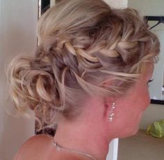 low bun curly messy with braid
