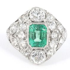 A platinum set emerald & diamond cocktail ring containing a cushion cut emerald weighing approximately 1 carat & approximately carat of old cut diamonds, circa Platinum Diamond Rings, Emerald Diamond, Diamond Cuts, Emerald Rings, Art Deco Diamond, Antique Rings, Cocktail Rings, Jewelry Rings, Antiques