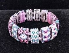 Easy on, easy off stretch bracelet just for Mom. You can never fully express just how much she means to you, but this bracelet can be a reminder to Mom that she is indeed loved. A unique, colorful and comfortable stretch bracelet with the sweet sentiment I LOVE YOU MOM inside the