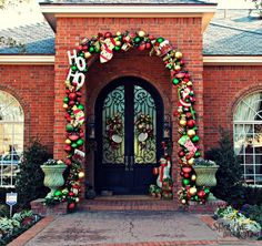 Show Me A Ho Ho Happy Christmas Doorway!  Santa and Mrs. Claus would feel right at home with this inviting whimsical entrance. The homeowner wanted totransitionher entryway from herdressy sophisticated past decorations to a fun, happy, kid friendly entryway to welcome her new grandchildren! A green pre-lit faux pine garland provides the sturdy foundation for the plentiful assortment of red, green, and gold shatterproof balls (the garland and balls were the base for the old…