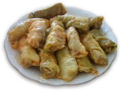 Sarma is a savory dish of grape, cabbage or chard leaves rolled around a filling usually based on minced meat, or a sweet dish of filo dough wrapped around a filling often of various kinds of chopped nuts. It is found in the cuisines of the former Ottoman Empire from the Middle East to the Balkans and Central Europe.