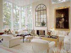 What you leave out of a room is always just as important as what you put in it: the absence of curtains and a quiet neutral range keeps Louis XV lines and gilt details current.  Veranda Magazine, Stan Topol.  Beautiful and I love the high, high ceilings too...everything always effects everything else when Staging any room....