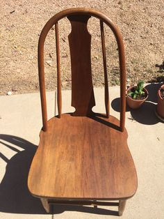 Marietta chair company circa early 1900's? Not sure kind of wood. Cleaned, sanded and stained. She still has some life in her. Goodwill find for $3.00