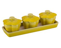 From Le Creuset a set of 3 Flower Cocottes with Tray $50.00 on their website: http://www.lecreuset.com/bakeware/bakeware-sets/set-of-3-flower-cocottes-with-tray