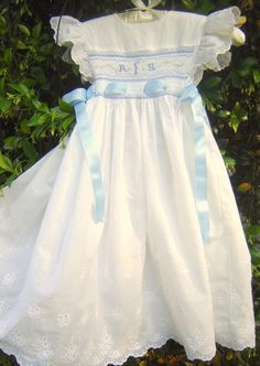 Beautiful smocked pinafore dress for little girl!