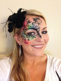 Mardi gras face painting with Tag neon rainbow Rachel's face painting #mask face painting masquerade face paint  https://www.facebook.com/PartytimeFacePaintingNailsAndFantasyMakeovers?ref=hl