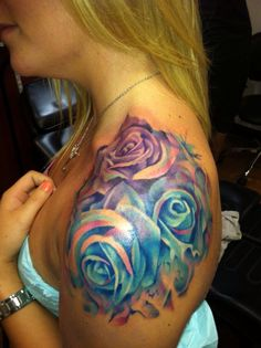 Gorgeous painted roses tattoo in jewel tone colors....