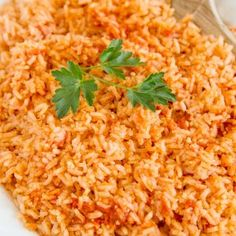 The BEST Authentic Mexican Rice that is so good and so easy, it will become THE side dish to make with all of your Mexican dishes. Perfect for Cinco de Mayo. Mexican Dishes, Mexican Food Recipes, Poke Bol, Authentic Mexican Rice, Plats Weight Watchers, Fettucine Alfredo, Sandwiches, Baked Chicken, Lemon Chicken
