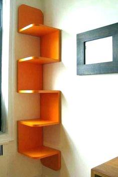 Wall mounted bookshelves designs modern wall bookshelves one modern wall mounted wall mounted shelf ideas Corner Shelf Design, Unique Wall Shelves, Wall Mounted Corner Shelves, Corner Bookshelves, Floating Bookshelves, Floating Corner Shelves, Shelves In Bedroom, Bookshelf Design, Modern Shelving