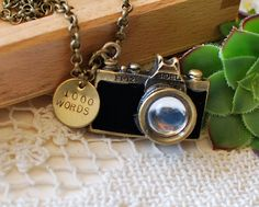 1000 Words Camera Necklace Hand Stamped Charm by SceneNotHerd, $25.00