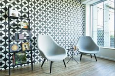 office interior by idstudio,  chill out corner with chairs from HAY and bookstand from Hem handmade tiles from Polish producer Purpura