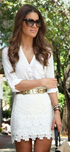 White shirt and floral lace skirt with gold accents.