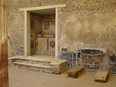 On the SW side of the atrium is the household lararium adorned w/frescoes imitating precious marbles. Beside the lararium are two bases for a substantial safe - AD 79 eruption Pompeii And Herculaneum, Pompeii Italy, Ancient Rome, Ancient History, Empire Romain, Roman City, Roman History, Frozen In Time, Southern Italy