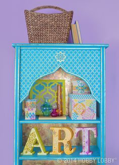This quirky secondhand bookshelf got the mother of all upgrades, thanks to a trendy teal paint job and a gorgeous Moroccan-inspired stencil.