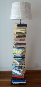 DIY upcycled book lamp made from old books, an Ikea lamp stand and a plain shade decoupaged in pages from an old book.