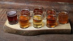 """Our Hand Built """"Live Edge"""" Beer Tasting Tray. This model holds 8. Visit our website at vibe reclaimed.com and email us about custom tray orders!"""