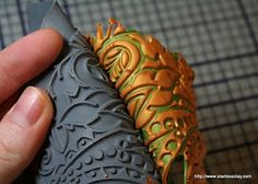 Lisa Pavelka's Texture Sheet to create a leaf ornament with cookie cutter.  #Polymer #Clay #Tutorials