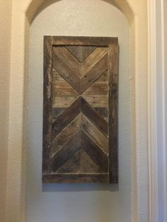 Handmade art made entirely of reclaimed pallet wood. The wood is in its natural form, it has not been painted or stained. Each board was specifically chosen for its uniqueness and rich color variation. Dimensions are 21 x41 Hanging hardware is attached on back.