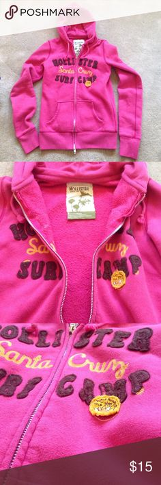 "Reddish/Pink Hollister zip up hoodie Gently worn Hollister ""Santa Cruz"" fleece lined zip up hoodie with front pockets. Small yellow logo reads ""Sunshine Makes Me Smile"". Third picture shows the gentle wear from washing. Size S. 60% cotton 40% polyester. Hollister Sweaters"