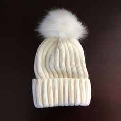 "Shop Women's Cream size OS Hats at a discounted price at Poshmark. Description: Cozy and warm cotton knit hat with removable faux fur pom pom. Removed with a snap - literally! Hat measures flat 12"" x 7"". Comes in black, cream & beige. One size fits most.. Sold by abierfriend. Fast delivery, full service customer support."