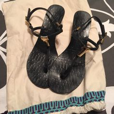 "Tory Burch Pauline Demi-Wedge Sandals Tory Burch ""Pauline"" Demi-wedge black leather sandals. These are gorgeous! Size 8 1/2. In excellent condition with normal signs of wear to soles. Gold stacked T logos and stamped on leather on footbeds. Gold buckles. Made in Brazil. 2 inch wedge heels. Perfect! Includes dust bag! Super fast shipping!!  Offers are welcome ✨ Tory Burch Shoes Sandals"