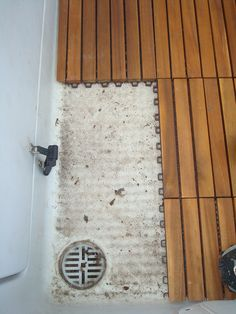 DIY Teak Tile Flooring: Teak tiles refresh a tired old boat deck or shower floor! http://www.teakwoodcentral.com/le-click-teak-flooring