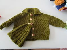 Our Knit & Natter Group Hand Knitted this Green Baby Cardigan & Hat