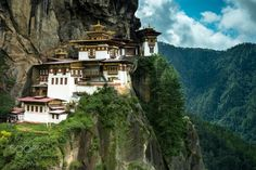 Paro Taktsang Monastery - PARO, BHUTAN - AUGUST 11, 2014: Paro Taktsang Monastery is the most famous buddhist temple complex of Bhutan which clings to a cliff, 3120 meters above the sea level on the upper side of Paro valley, Bhutan.