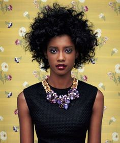 Amp up the natural texture of your hair, then throw on a statement necklace.