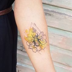 Black Dotted Bee With Yellow Spark. Yellow is the representative color of honey bees. This symbol is best depicted in this tattoo.