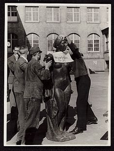 Members of the Monuments, Fine Arts & Archives section of the military, prepare Aristide Maillol's sculpture Baigneuse à la draperie, looted during World War II. Citation: Aristide Maillol sculpture recovery, 1946 May 24 / unidentified photographer. James J. Rorimer papers, Archives of American Art, Smithsonian Institution.