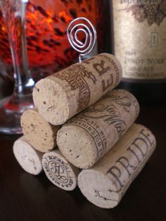 Wine Cork Pyramid Table Number Holder.  I'm going to do a spin on this idea for my table numbers!!  Can't wait!!!