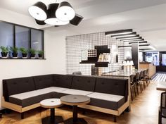 I really like the black and white color scheme of this cafe. It really puts the emphasis on the geometric shapes throughout the room.