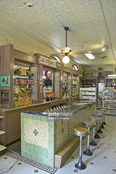 Interior of old drug store with bar stools and soda fountain in French Quarter of New Orleans LA
